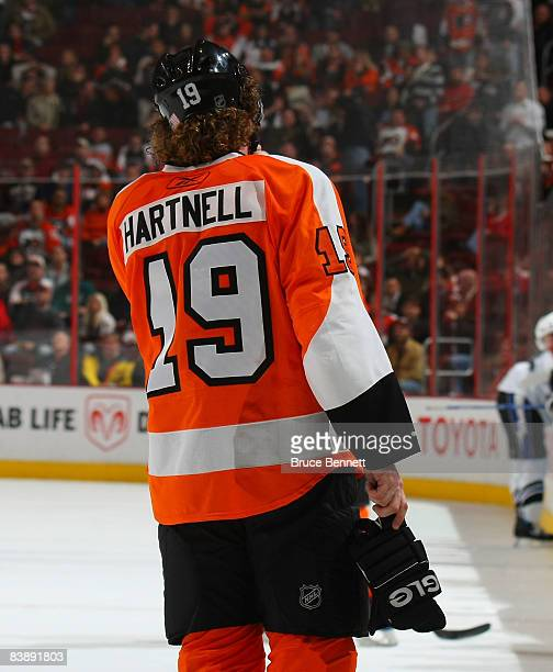 Scott Hartnell of the Philadelphia Flyers leaves the ice after getting penalized for throwing his glove at the puck in his game against the Tampa Bay...