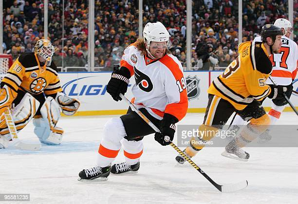 Scott Hartnell of the Philadelphia Flyers skates against Goaltender Tim Thomas and Derek Morris of the Boston Bruins on January 1 2010 during the...
