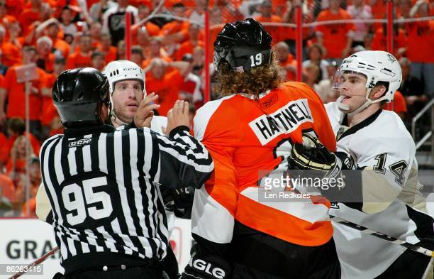 Scott Hartnell of the Philadelphia Flyers tangles with Rob Scuderi and Chris Kunitz of the Pittsburgh Penguins during Game Six of the Eastern...
