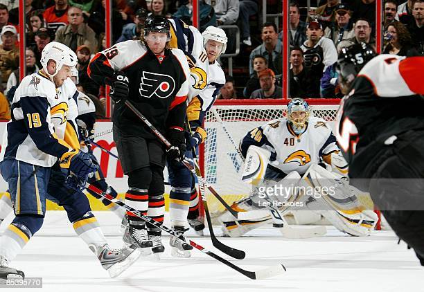 Scott Hartnell tries to deflect a shot on goal by Braydon Coburn of the Philadelphia Flyers against Tim Connolly Henrik Tallinder and Patrick Lalime...