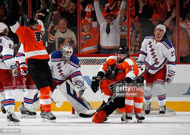 Scott Hartnell, Wayne Simmonds and Claude Giroux of the Philadelphia Flyers celebrate Simmond's powerplay goal at 7:08 of the first period against...