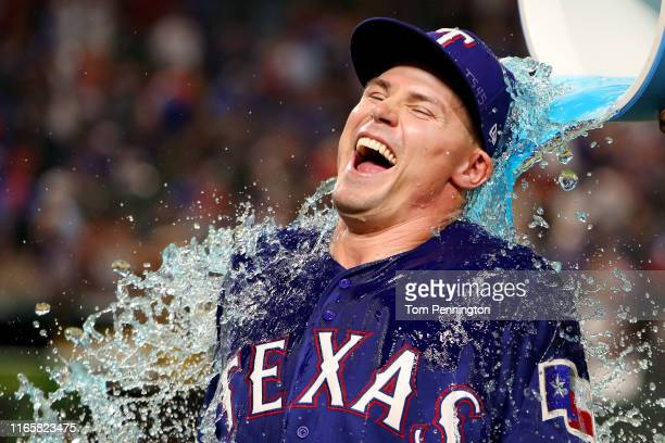 Scott Heineman of the Texas Rangers is soaked with POWERADE after the Texas Rangers beat the Detroit Tigers 5-4 in his first Major League debut at...