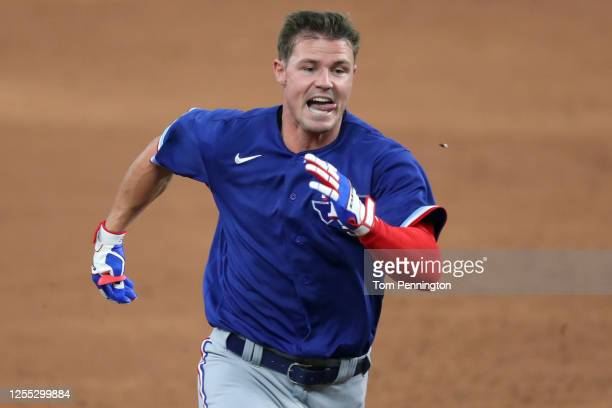 Scott Heineman of the Texas Rangers rounds the bases after hitting a triple during an intrasquad game during Major League Baseball summer workouts at...