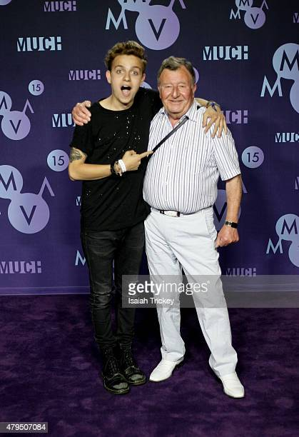 Scott Helman and grandfather Alan Davis pose in the press room at the 2015 Much Music Video Awards at MuchMusic HQ on June 21 2015 in Toronto Canada