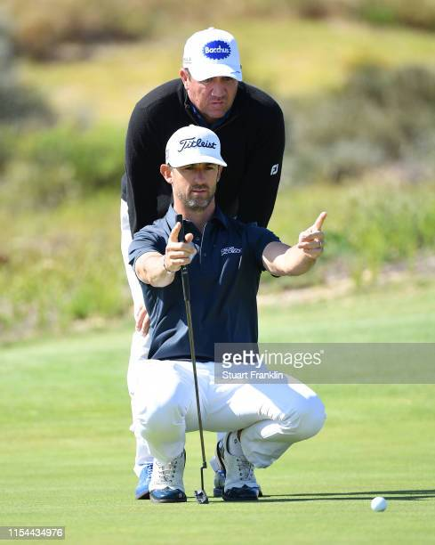 Scott Hend and Wade Ormsby of Australia line up a putt on a playoff hole during Day One of the GolfSixes at Oitavos Dunes on June 07 2019 in Cascais...