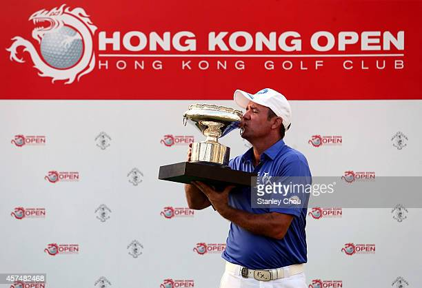 Scott Hend of Australia celebrates with the trophy after winning the final round of the 2014 Hong Kong open at The Hong Kong Golf Club on October 19,...