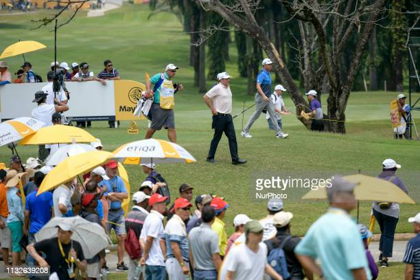 Scott Hend of Australia David Lipsky of United States of America are pictured on the 11th hole on Day Four of the Maybank Championship at Saujana...