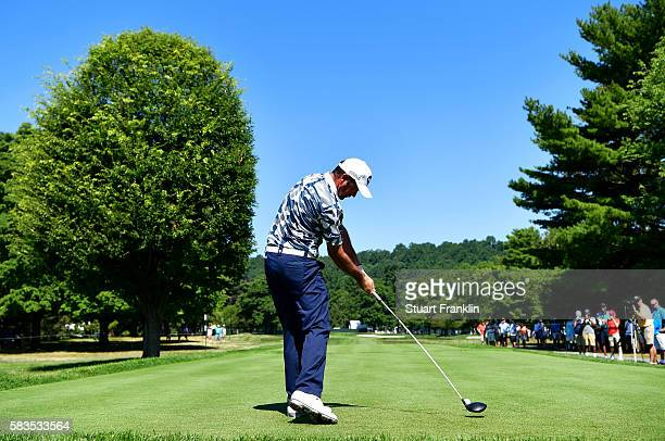 Scott Hend of Australia hits a tee shot on the 11th hole during a practice round prior to the 2016 PGA Championship at Baltusrol Golf Club on July 26...