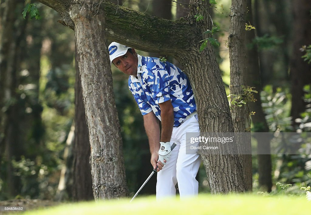 Scott Hend of Australia hits his 2nd shot on the 13th hole during day three of the BMW PGA Championship at Wentworth on May 28, 2016 in Virginia Water, England.