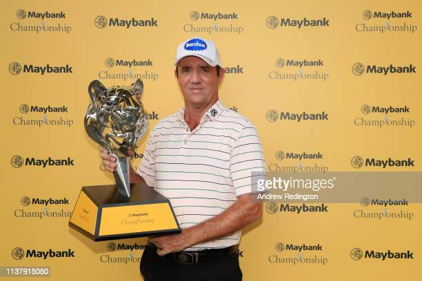 Scott Hend of Australia holds the trophy after he wins the play off match against Nacho Elvira of Spain during Day Four of the Maybank Championship...