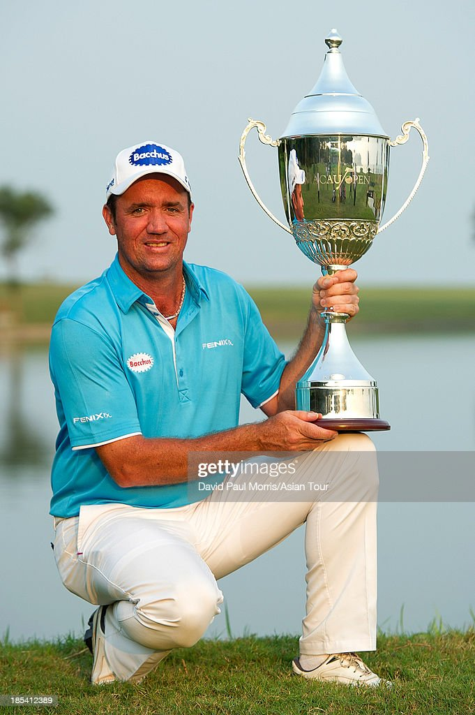 Scott Hend of Australia holds the trophy after winning the 2013 Venetian Macau Open on October 20, 2013 at the Macau Golf & Country Club in Macau. Hend finished with a 16 under par 268 taking home US