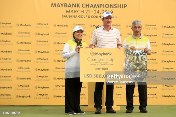 Scott Hend of Australia is given the prize money by Abdullah of Pahang King of Malaysia after he wins the play off match against Nacho Elvira of...