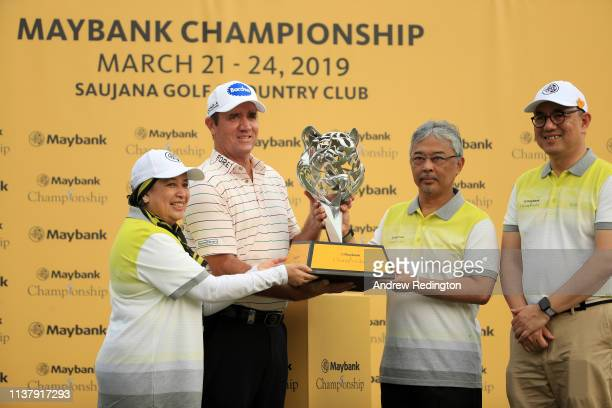 Scott Hend of Australia is given the trophy by Abdullah of Pahang King of Malaysia after he wins the play off match against Nacho Elvira of Spain...