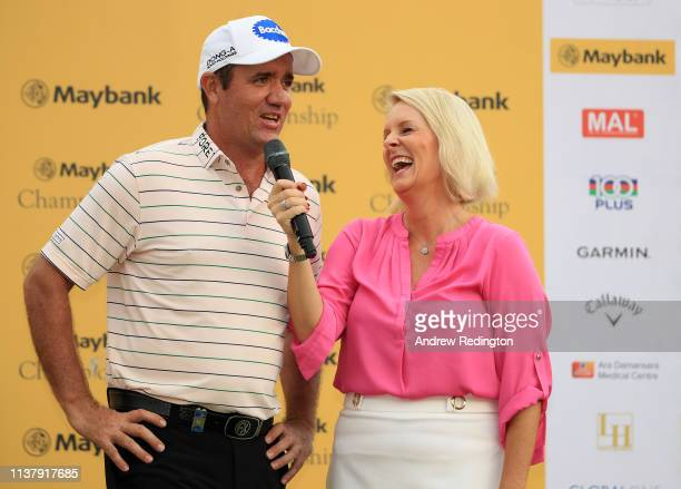 Scott Hend of Australia is interviewed at the presentation by TV presenter Kate Burton after he wins the play off match against Nacho Elvira of Spain...