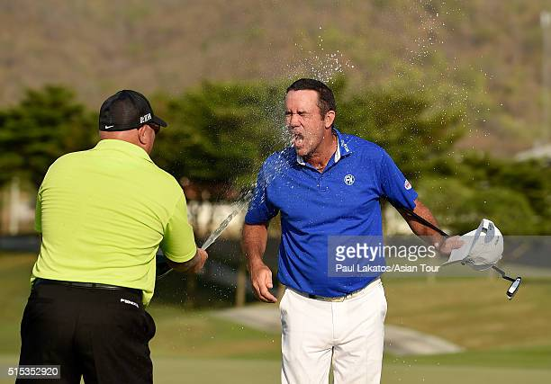 Scott Hend of Australia is sprayed with champagne on the 18th green after his win during round four of the True Thailand Classic presented by Chang...