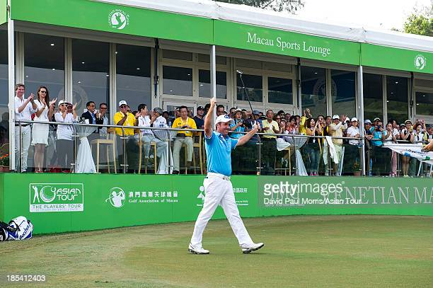 Scott Hend of Australia lifts his arms in victory after wining the 2013 Venetian Macau Open on October 20 2013 at the Macau Golf Country Club in...