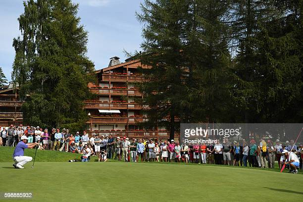Scott Hend of Australia lines up a putt on the 16th hole during the third round of the Omega European Masters at CranssurSierre Golf Club on...