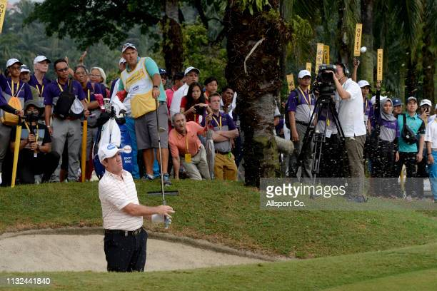 Scott Hend of Australia plays a bunker shot on the 18th hole during a play off with Nacho Elvira of Spain during Day Four of the Maybank Championship...
