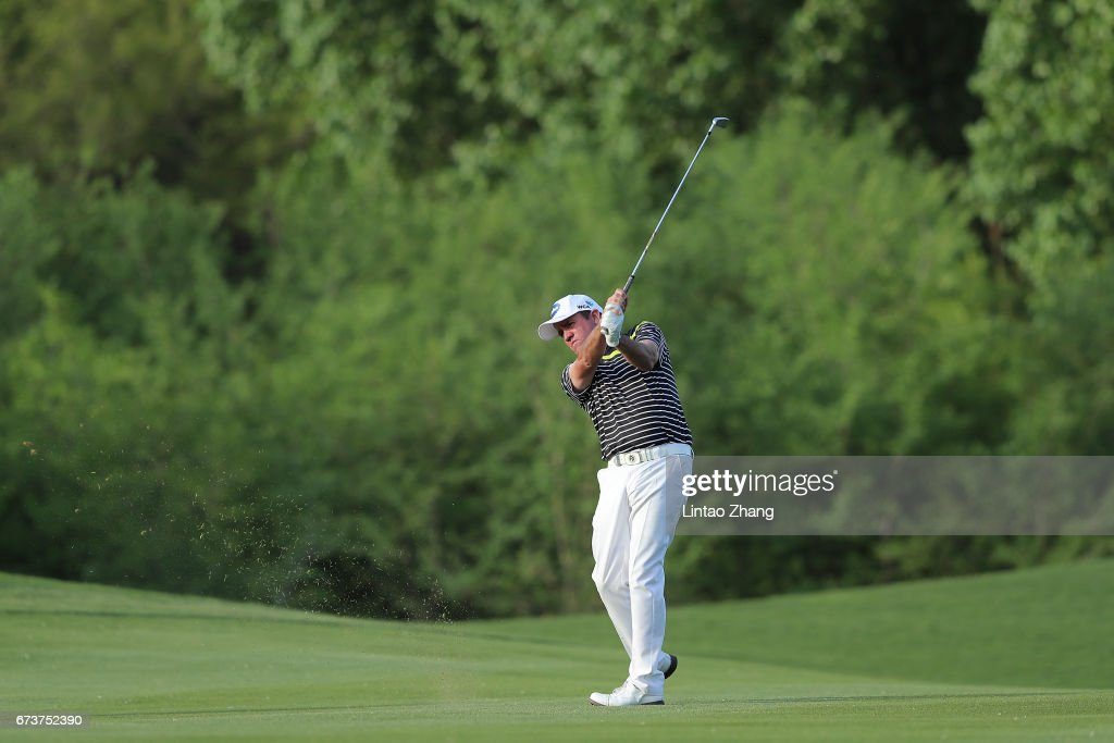 Scott Hend of Australia plays a shot during the first round of the 2017 Volvo China open at Topwin Golf and Country Club on April 27, 2017 in Beijing, China.