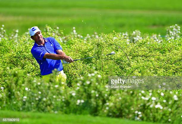 Scott Hend of Australia plays from the rough on the 3rd hole during the first round on day one of the Nordea Masters at Bro Hof Slott Golf Club on...