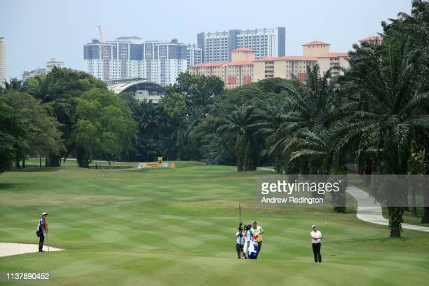 Scott Hend of Australia plays his second shot on the 14th hole during Day Four of the Maybank Championship at Saujana Golf Country Club Palm Course...