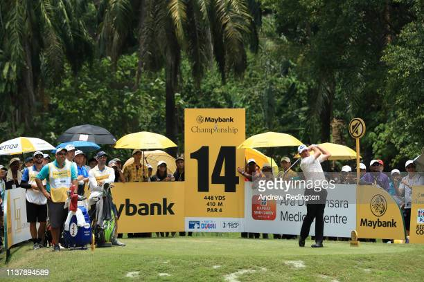 Scott Hend of Australia plays his shot off the 14th tee during Day Four of the Maybank Championship at Saujana Golf Country Club Palm Course on March...
