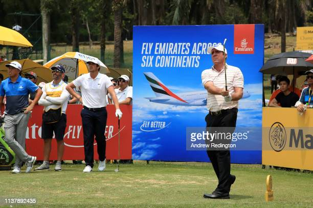 Scott Hend of Australia plays his shot on the 16th during Day Four of the Maybank Championship at Saujana Golf Country Club Palm Course on March 24...