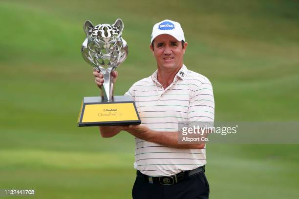 Scott Hend of Australia poses with the Maybank Championship Trophy after he won it during Day Four of the Maybank Championship at Saujana Golf and...
