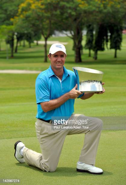 Scott Hend of Australia poses with the winner's trophy during day four of the ISPS Handa Singapore Classic at Orchid Country Club on April 8 2012 in...