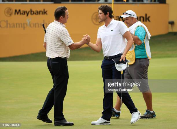 Scott Hend of Australia shakes hands he wins the play off match against Nacho Elvira of Spain during Day Four of the Maybank Championship at Saujana...