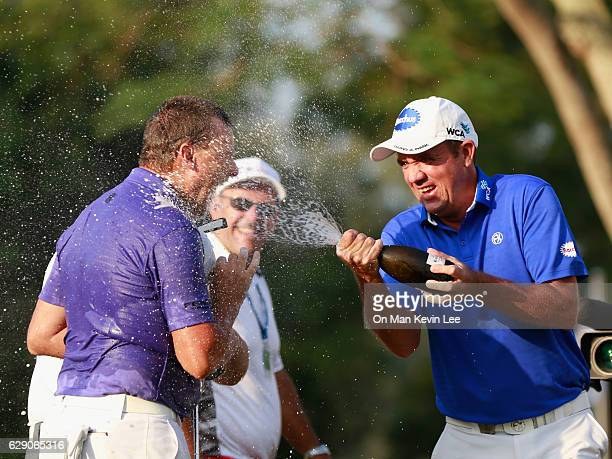Scott Hend of Australia sprays champagne on Sam Brazel of Australia after he won the final round of 2016 UBS Hong Kong Open at The Hong Kong Golf...