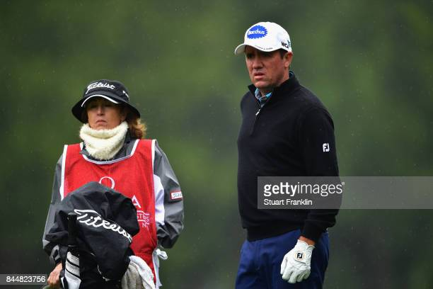Scott Hend of Australia stands with his wife and caddie Leanne on the 2nd during Day Three of the 2017 Omega Masters at CranssurSierre Golf Club on...