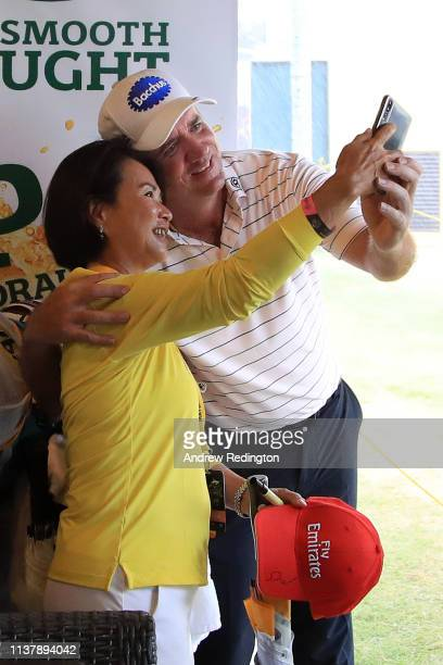 Scott Hend of Australia takes shelter from the storm in the club house and takes a selfie photoduring Day Four of the Maybank Championship at Saujana...