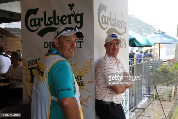 Scott Hend of Australia takes shelter from the storm in the club house during Day Four of the Maybank Championship at Saujana Golf Country Club Palm...