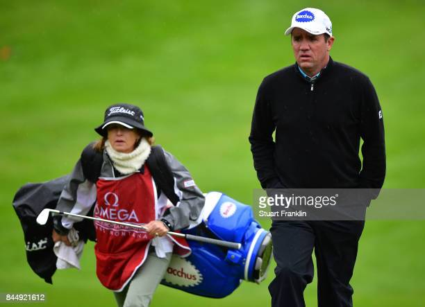Scott Hend of Australia walks with his caadie wife Leanne Hend on the first hole during the third round of the Omega European Masters at...
