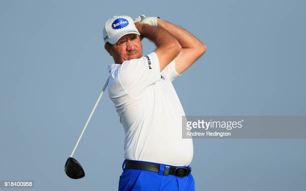 Scott Hend of Australia watches his tee shot on the par five 12th hole during the first round of the NBO Oman Open at Al Mouj Golf on February 15...