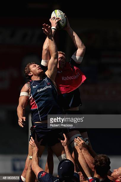 Scott Higginbotham and Sam Jeffries contest a high ball during a Melbourne Rebels Super Rugby training session at Visy Park on April 1 2014 in...