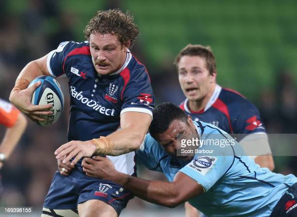 Scott Higginbotham of the Rebels is tackled during the round 15 Super Rugby match between the Rebels and the Waratahs at AAMI Park on May 24 2013 in...