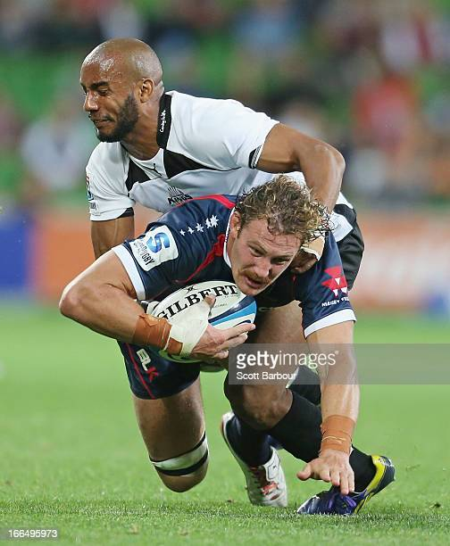 Scott Higginbotham of the Rebels is tackled during the round nine Super Rugby match between the Rebels and the Kings at AAMI Park on April 13 2013 in...
