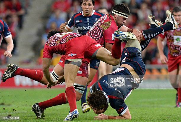 Scott Higginbotham of the Rebels is upended in a tackle during the round 16 Super Rugby match between the Reds and the Rebels at Suncorp Stadium on...