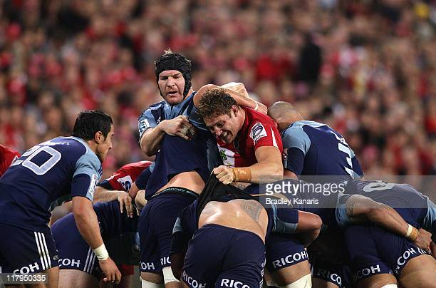 Scott Higginbotham of the Reds and Ali Williams of the Blues compete in the scrum during the Super Rugby Semi Final match between the Reds and the...