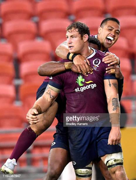 Scott Higginbotham of the Reds is congratulated by team mate Duncan Paia'aua after scoring a try during the round 17 Super Rugby match between the...