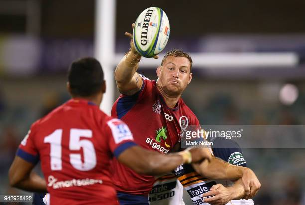 Scott Higginbotham of the Reds looks to offload during the round 8 Super Rugby match between the Brumbies and the Reds at University of Canberra Oval...