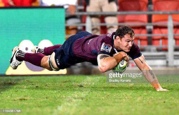 Scott Higginbotham of the Reds scores the match winning try during the round 17 Super Rugby match between the Reds and the Blues at Suncorp Stadium...