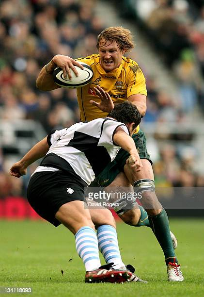 Scott Higginbotham of The Wallabies is tackled by Eusebio Guinazu of the Barbarians during the Killik Cup match between the Barbarians and Australia...