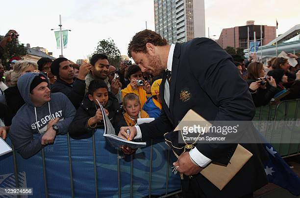 Scott Higginbotham of the Wallabies signs autographs during the Australian Wallabies IRB Rugby World Cup 2011 official team welcome ceremony at Aotea...