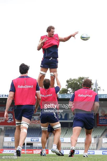 Scott Higginbotham passes off the ball during a Melbourne Rebels Super Rugby training session at Visy Park on March 11 2014 in Melbourne Australia