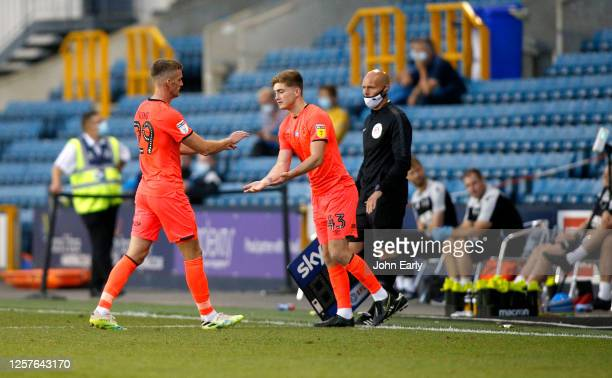 Scott High of Huddersfield Town enters the field during the Sky Bet Championship match between Millwall and Huddersfield Town at The Den on July 22...