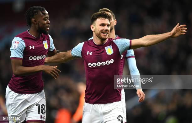 Scott Hogan of Aston Villa celebrates after scoring his sides third goal with Joshua Onomah of Aston Villa during the Sky Bet Championship match...
