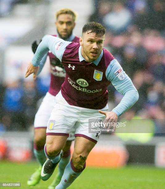 Scott Hogan of Aston Villa celebrates his goal for Aston Villa during the Sky Bet Championship match between Wigan Athletic and Aston Villa at the DW...
